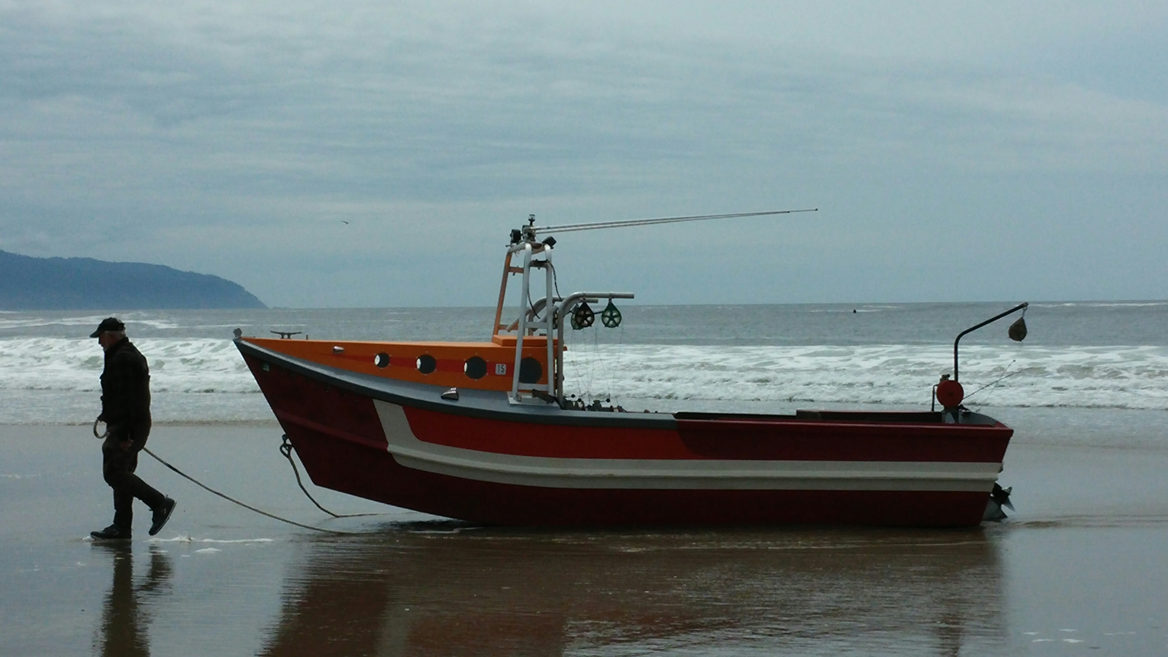 A dory fisherman brings in his boat in Pacific City, Oregon.