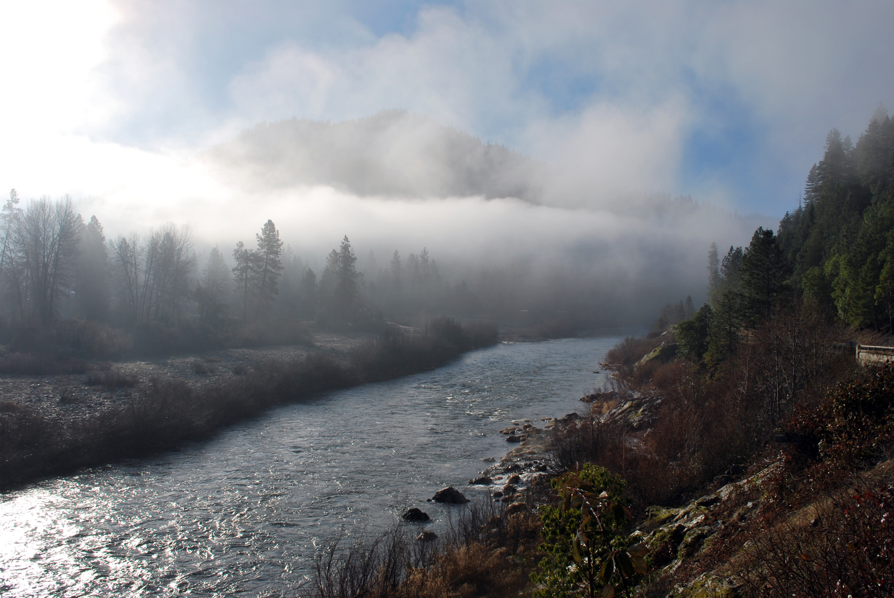 The Klamath River flows under a fog bank