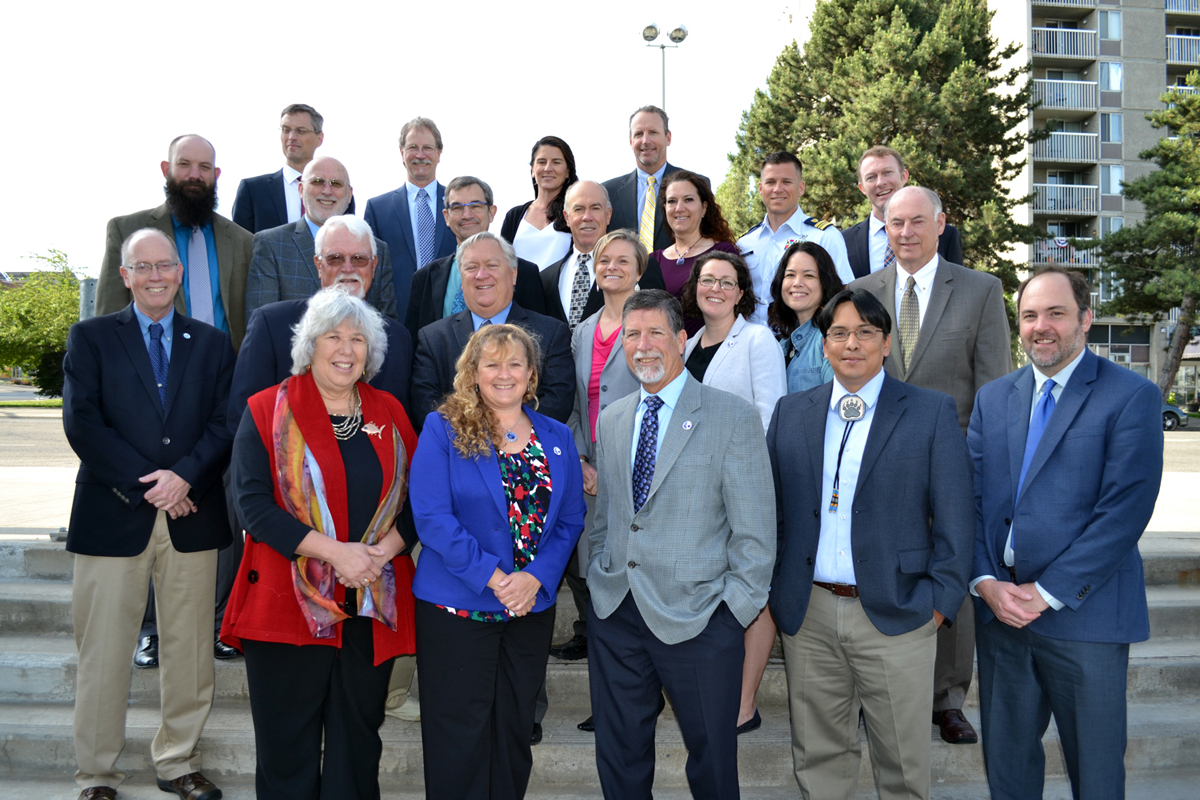 A group photo of the members of the Pacific Fishery Management Council (and some Council staff) wearing professional dress