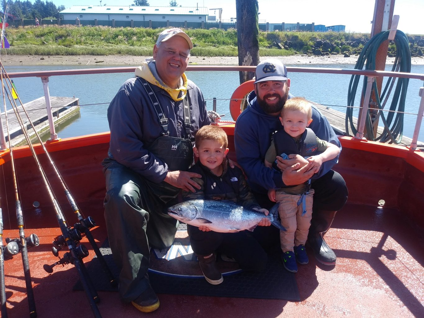 A family on a fishing boat
