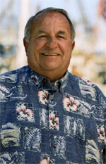 Smiling man in a Hawaiian shirt