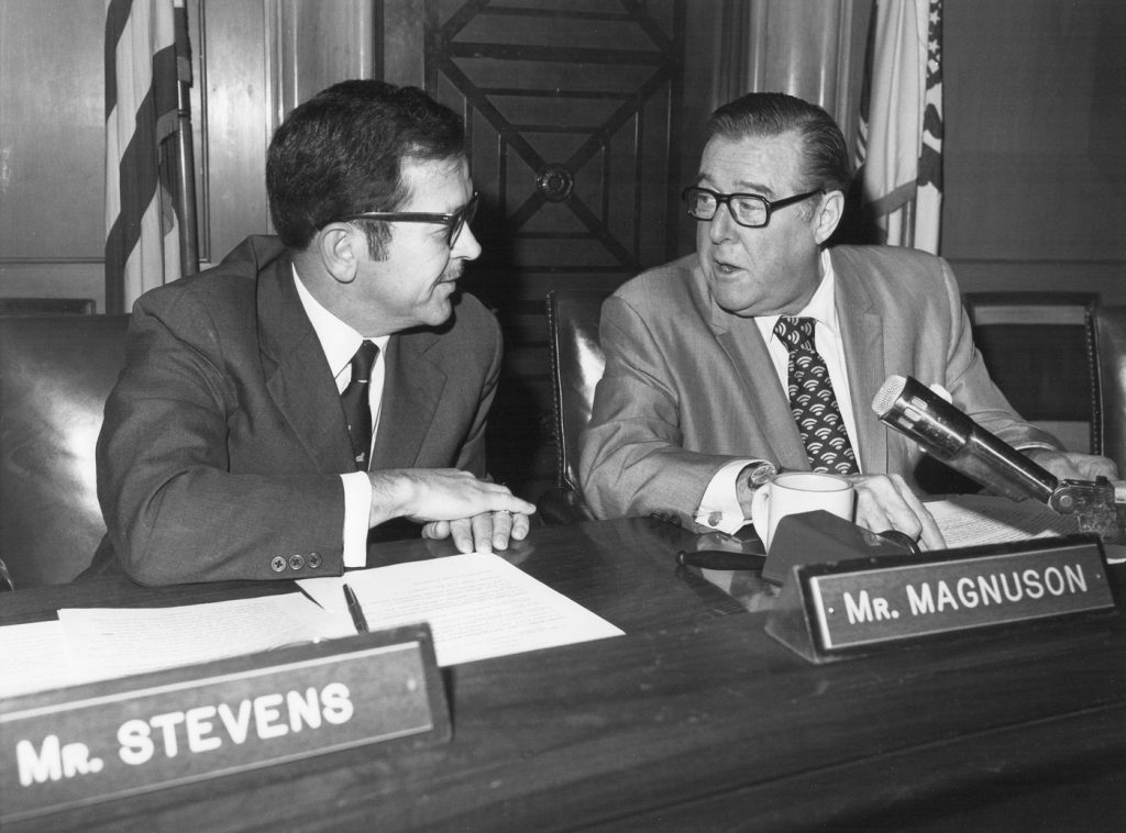 Black and white photo of two senators talking
